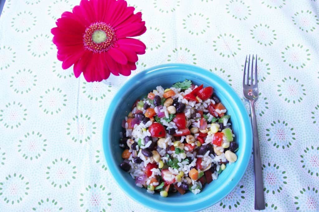 This rice salad recipe is ADDICTING! One of my all time favorite summer recipes. It couldn't be easier to whip up!