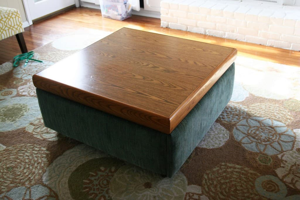 Take an ugly coffee table and transform it into a DIY ottoman! Save SO much