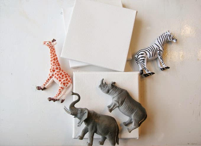 For some easy DIY art, make these mini animal canvases out of plastic toys, super glue and paint! They are so funky and unique for a nursery or child's bedroom!