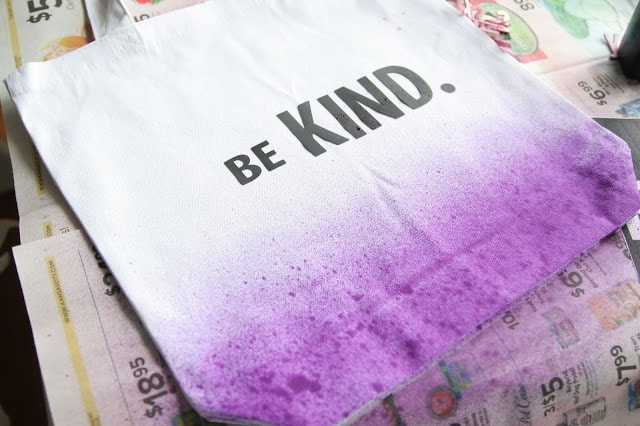 These tie dye sprayed canvas bags are super easy to make and can be personlized to say anything!