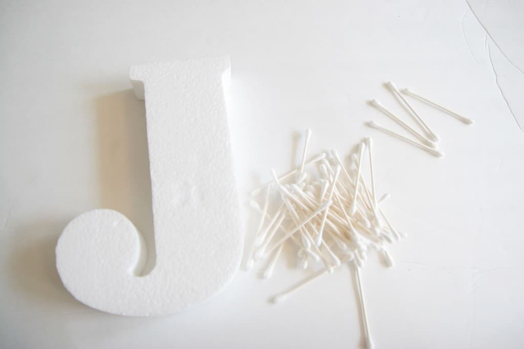 Make an adorable letter with cotton swabs! This Q-Tip craft is a great activity for kids!