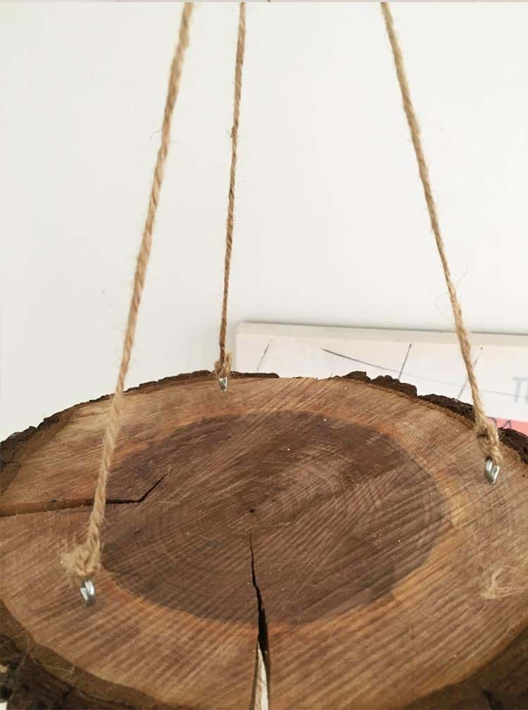 All you need is a wood slice and a few other materials to make an adorable baby mobile. Check out the full tutorial to make your own crib mobile today!