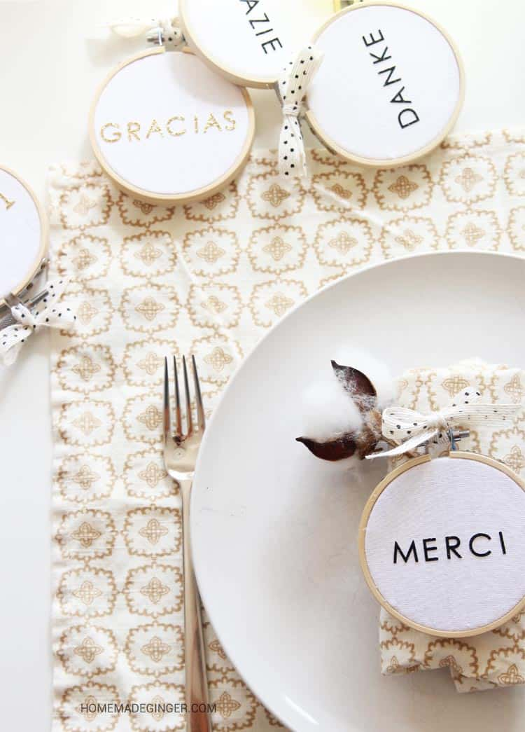 "Create a Thanksgiving place setting with embroidery hoops and stickers. Spell out ""thank you"" in different languages for this modern Thanksgiving craft!"