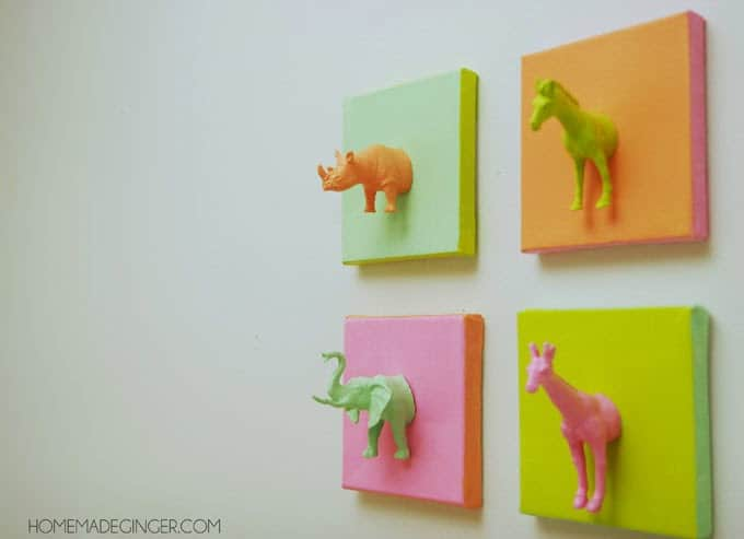 Make these mini animal canvases using plastic toys and paint! Such a fun idea for some DIY nursery art.