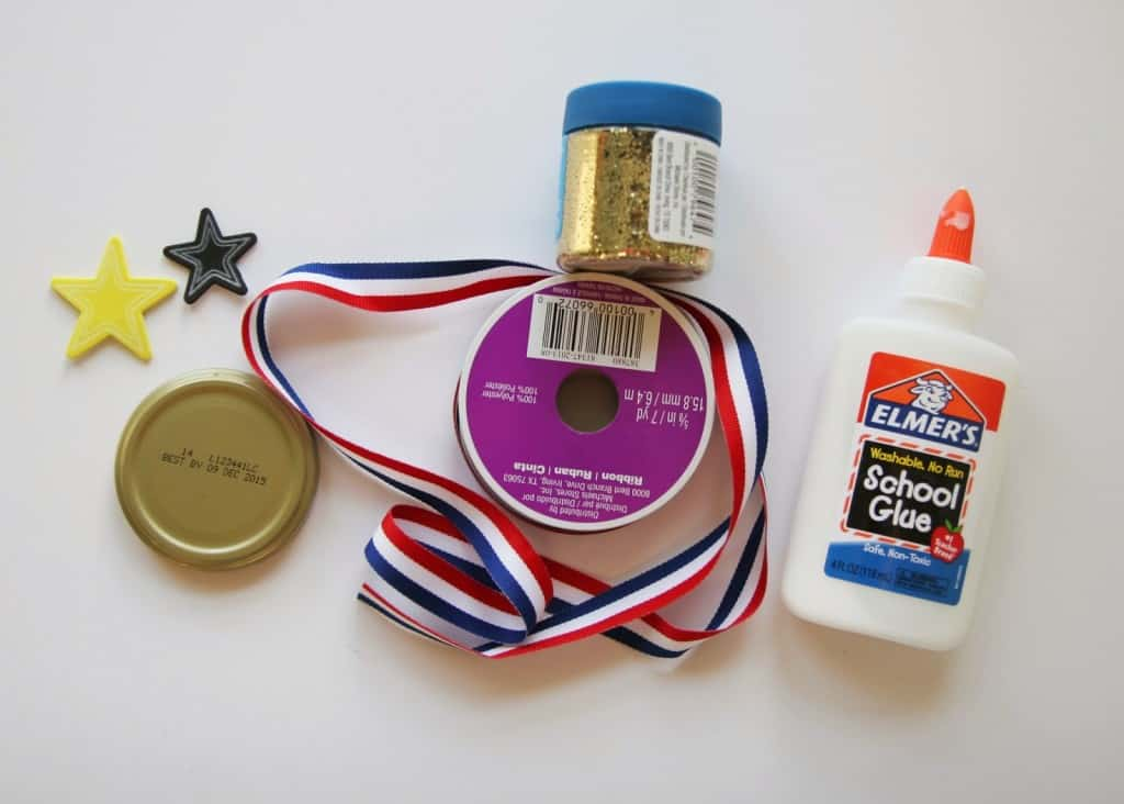 This easy olympic medal craft for kids uses old jar lids and glitter to make the cutest olympic medals in no time. This craft is great for all ages!