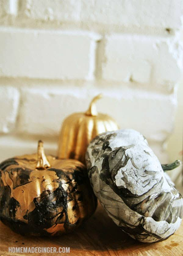 diy marbled pumpkins using nail polsih on homemade ginger