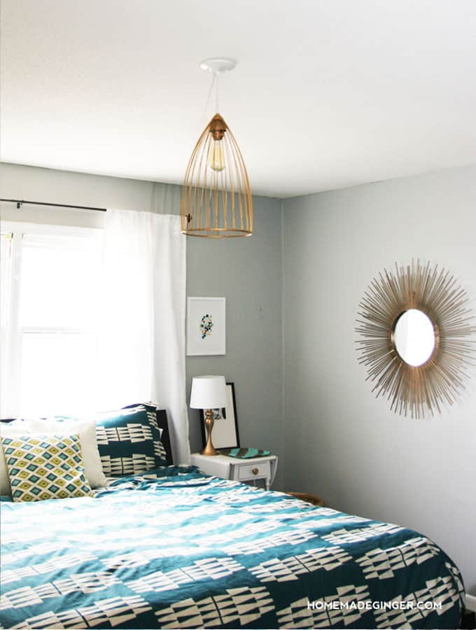 Make some DIY lighting using an inexpensive cage! This custom pendant light fixture is great for a bedroom!