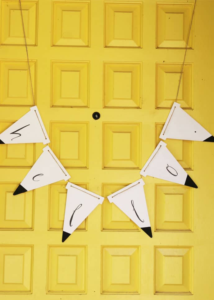 Make a modern wooden bunting to adorn your door!