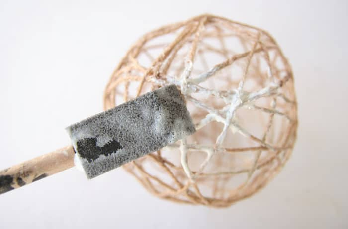 Make these DIY glow in the dark twine balls for Halloween. They are cute enough to go with your fall decor in the day but turn spooky at night!