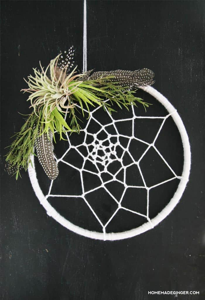 Learn how to make a dream catcher wreath for under $10. This is a unique and modern DIY home decor idea!