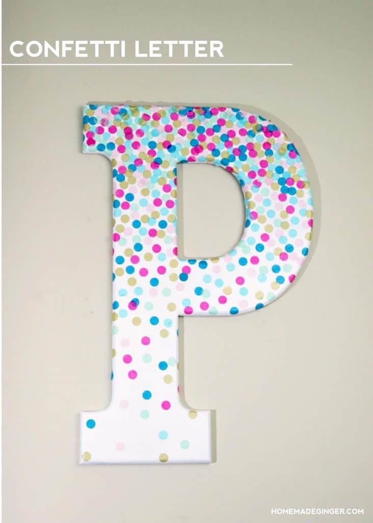 Make some DIY wall art by decorating a letter with confetti. This is perfect for some DIY nursery decor!