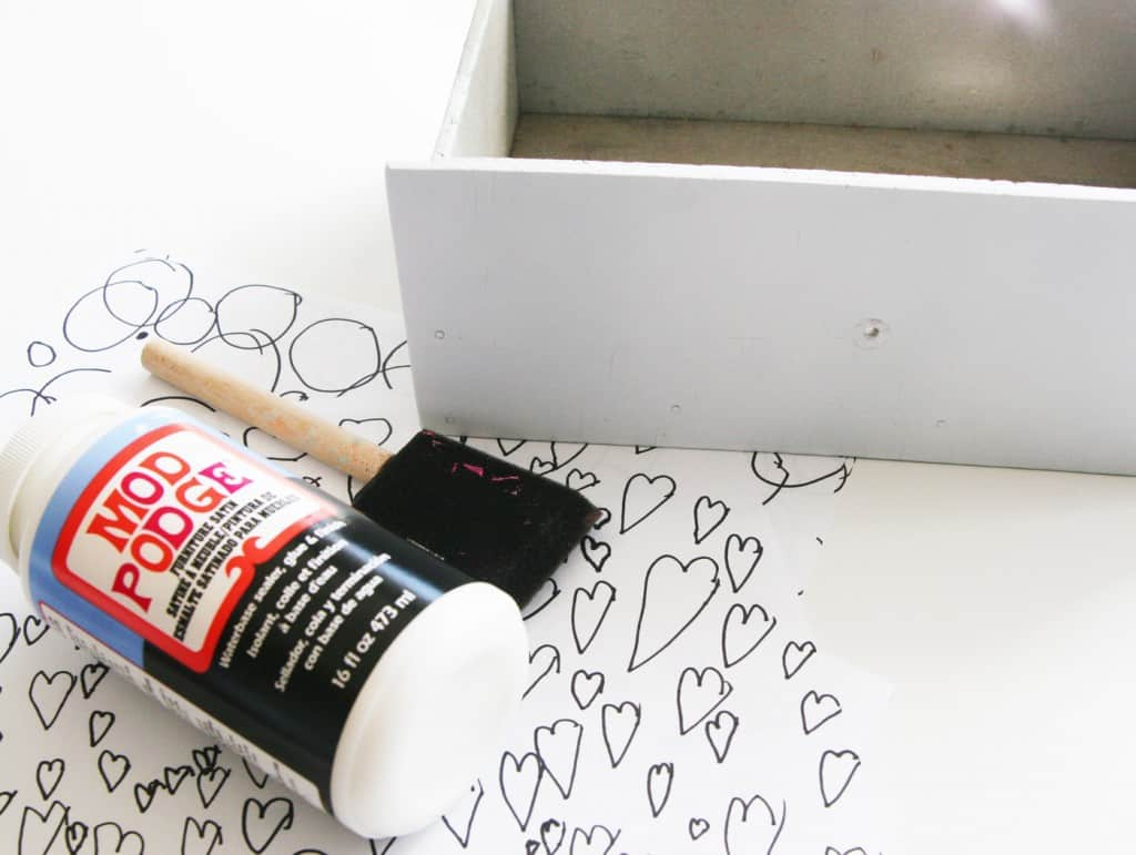 Learn how to do a DIY playroom furniture update for free. It's easy to update a furniture piece with kids artwork and just a few supplies!