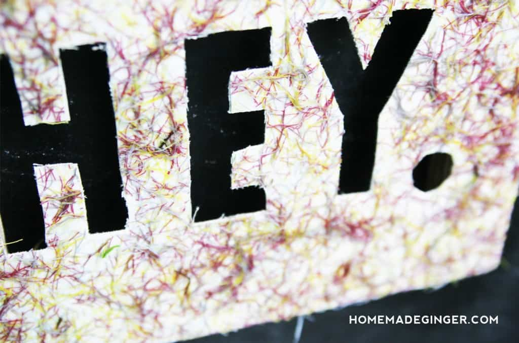 Create some DIY string art using thread and Mod Podge. Customize these canvases to say anything you want for some cheerful DIY decor!