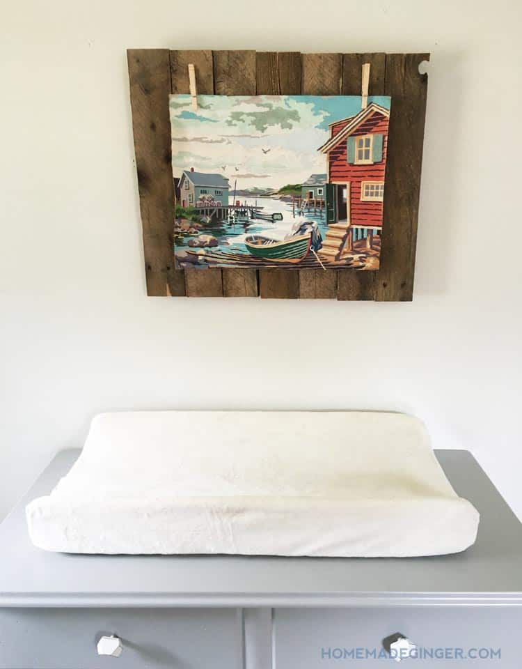 This easy pallet project is a great way to display an old painting without damaging it! Perfect for a boys nursery decor!