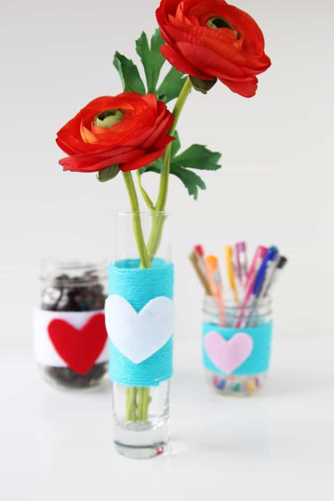 For some easy Valentine's Day decor, make these super cute yarn wrapped mason jars! This is such an easy Valentines craft!