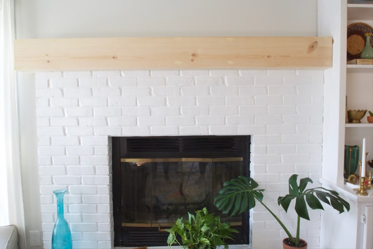 Learn how to update a brick fireplace with just a little work! This fireplace makeover is clean and modern!