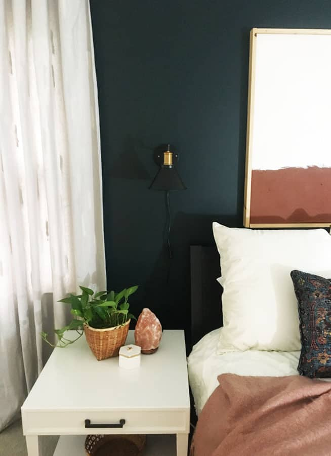 Making DIY Drop Cloth Curtains is so easy! These have a simple brush stroke pattern to give them a subtle pattern. This DIY curtain tutorial is so easy!