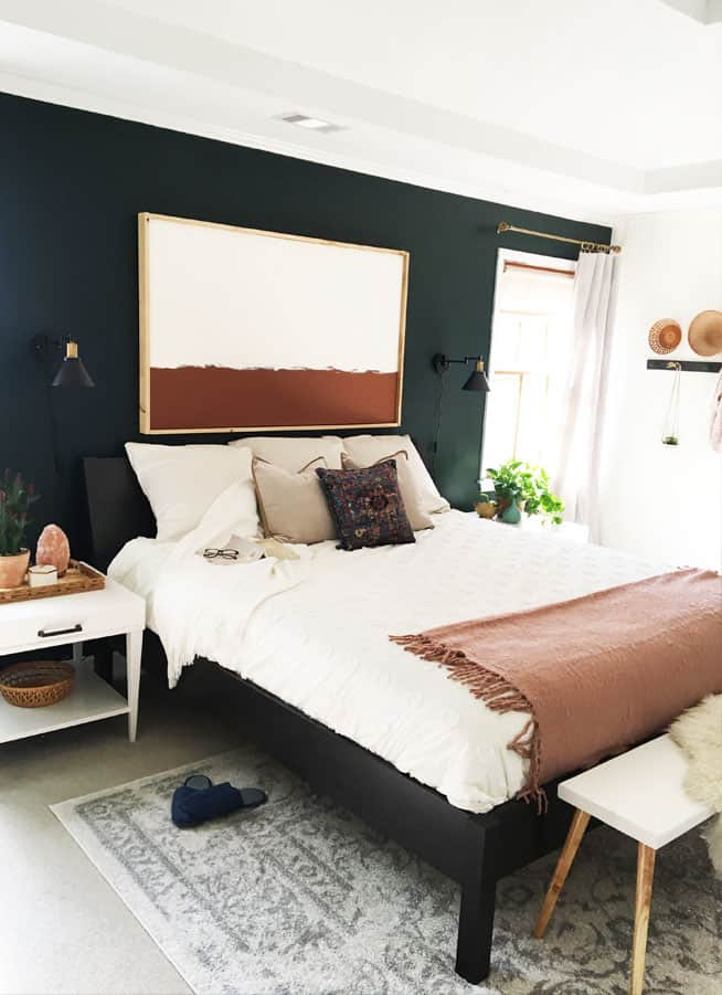 This master bedroom makeover reveal was done on a major budget. Lots of DIY home decor projects make this bedroom have character!