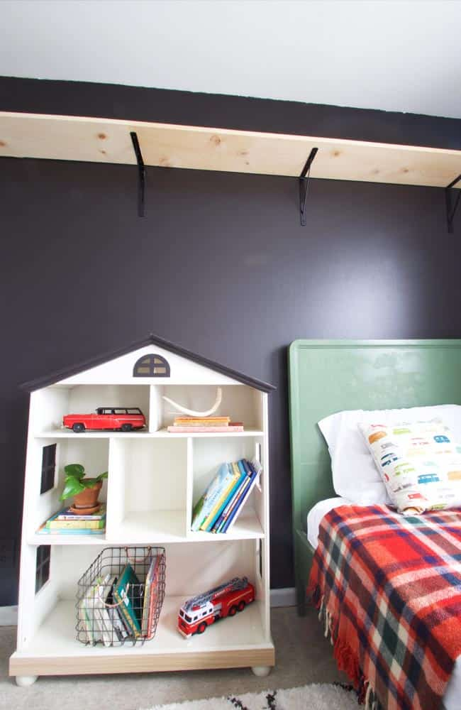 For an easy bookcase makeover for kids, all you will need is some contact paper and paint to transform an old bookcase that you already have. This method will also work to make over a dollhouse for a little boy.