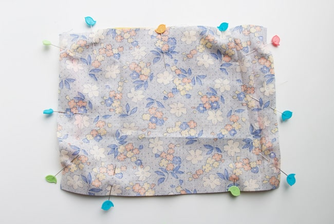 Learn how to sew a face mask using headbands. There is a shortage and elastic and masks with ties are difficult to wash, so use this tutorial to learn how to sew a face mask without elastic!