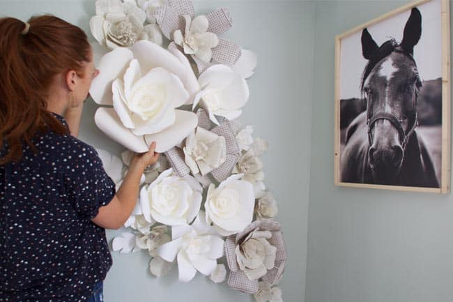 Learn how to make wall flowers out of pages to create an amazing paper flower wall. This diy wall decor craft is great for a kids room!