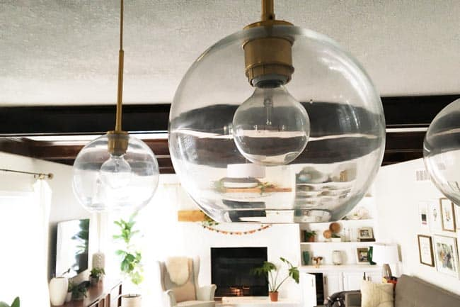 There are many methods to clean your glass pendant light depending on how dirty your fixture is or how much time you have. For a deep clean, use dish soap and water or make a paste out of baking soda and vinegar. For a quick, light clean you can use a natural based cleaner and a paper towel or  water and a polishing cloth.